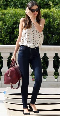 Black and white print H&M blouse, dark wash jeans, black patent flats. Accessorize with Calvin Klein purse, pearl earrings, and gold watch.
