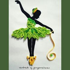 Quilling art paper ballerina in green dress