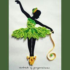 Quilling art paper ballerina in green dress