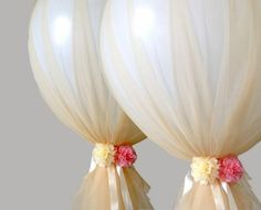 Cover balloons in tulle, tie with ribbon and add silk flowers for a beautiful finishing touch.  Afloral.com have giant latex balloons, tulle, ribbon, and a large assortment of high-quality silk flowers for your DIY wedding ideas.