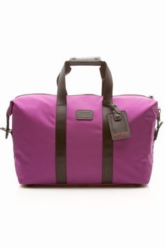 Small Soft Travel Satchel 22149 - Magenta. $295. I'm not usually a fan of purple, but sometimes it just comes together. I love the contrast on this one.