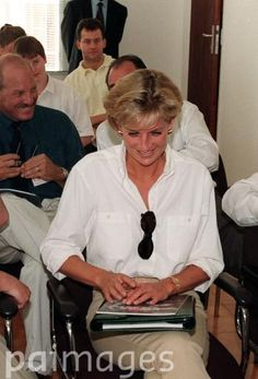 PA NEWS PHOTO 14/1/97 DIANA, THE PRINCESS OF WALES WITH HER BUTLER PAUL BURRELL (FAR BACK SEATED) AT A HEALTH CENTRE DURING HER VISIT TO ANGOLA