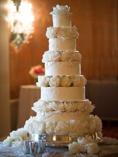 Scrolled tiers with white peonies wedding cake.