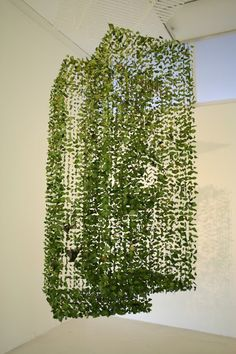 hanging lines of origami & leaves to make gemetric shapes
