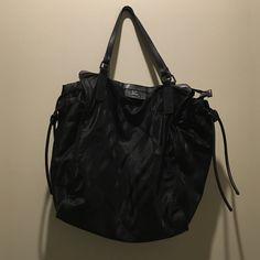 Burberry Tote This is a nylon black Burberry tote with two draw strings on the side. This is a classic Burberry pattern in all black . Good condition willing to negotiate, this did not come with a dust bag Burberry Bags Totes