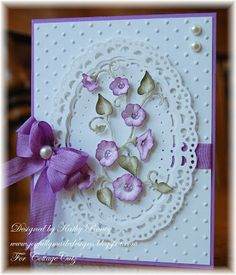 Kathy Roney: Joyfully Made Designs CottageCutz Dies: Morning Glory, Oval Doily & Frame Dies. Paper: Orchid Opulence (SU), Solar White (Neenah), Whisper White (SU). Ink: Hint of Pesto, Purple Hydrangea (VersaMagic). Accessories: Perfect Polka Dots Embossing Folder (SU), White Opal Liquid Pearls (Ranger), Lavender Seam Binding (Really Reasonable Ribbon), Bow-Easy, adhesive pearls.