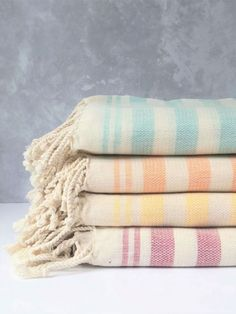 Kin and Kloth cotton Turkish towels are chic and stylish. Their striped design in muted colors is beautiful Perfect for beach holidays as it doesn't trap sand. It's also extremely lightweight, compact, absorbent and quick drying making it a perfect travel companion as well as bathroom accessory. The versatility of this towel doesn't end there as it can also be used as a gym towel, beautiful scarf, picnic blanket, throw or a stylish sarong amongst other things. | gym towel design #organic… Weaving Process, Hand Weaving, Gym Towel, Turkish Towels, Beach Holiday, Muted Colors, Stripes Design, Picnic Blanket, Compact