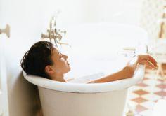 ストックフォト : Woman taking bath, rear view, close-up