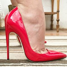 Red pumps and toe cleavage