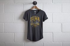 Tailgate Iowa Outback Bowl T-Shirt by  American Eagle Outfitters   Herky the Hawk, the face of Hawkeye athletics, is known for his rowdy demeanor, once starting an epic brawl with a U of Minnesota drumline member who challenged Herky's home field advantage. Shop the Tailgate Iowa Outback Bowl T-Shirt and check out more at AE.com.