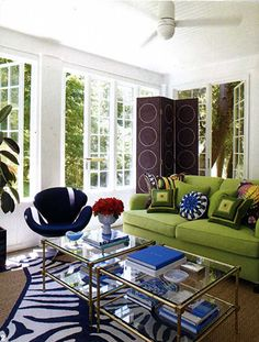 Liz Lange's County House by Jonathan Adler.  love the round pillow and green sofa.