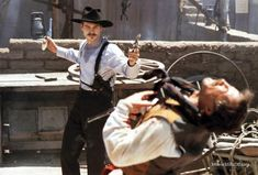 TOMBSTONE - Val Kilmer as 'Doc Holliday' at the OK Corral - Directed by George Cosmatos - Disney - Movie Still.