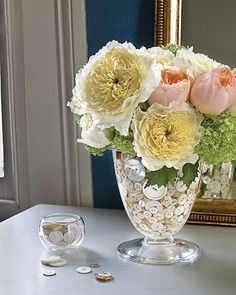 buttons in vase of flowers