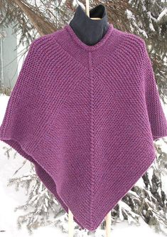 Knitting Pattern for Easy 50 x 50 Poncho - Garter stitch poncho that's as easy as counting to 50: diamond panels with 50 stitches on each side and 50 decreases with side panels of 50 stitches times 50 ridges. Chunky yarn. Designed by CabinFeverSisters