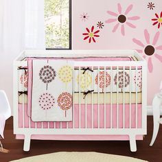 Same crib set as buy buy baby, i like the flowers on the wall.. What color could I paint the wall to match this bedding if I don't want it to be pink?