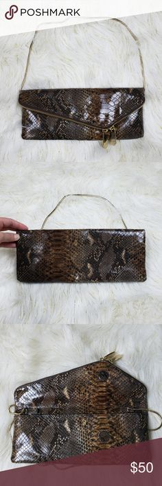 Henri Bendel Foldover Purse Slim Clutch Henri Bendel slim purse with straps. Straps can be tucked in for a clutch look. This is a foldover bag held by magnets. See pic #4 for red markings. henri bendel Bags