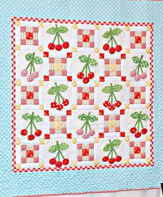 Bright Cheery Cherries Quilt. Cherry appliques are covered buttons.