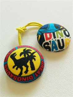This item listing is for a pair of dino-themed ponytail elastics. Made with a fabric covered button (aluminium), with thin snagless hair elastic. Fabric Covered Button, Dinosaurs, Ponytail, Buttons, Christmas Ornaments, Handmade Gifts, Holiday Decor, Craft Gifts, Horse Tail