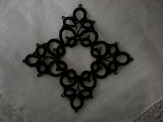 Black Four Corner Tatted Lace Medallion by designedkeepsakes, $10.00    You can create your own jewelry with this four corned motif. Measures approximately 2 1/2 x 2 1/2 inches. The circle in the middle would hang up to a 12mm bead. I used 20 size tatting thread with makes it a sturdy medallion to hold beads and chains.