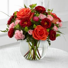 Better Homes and Gardens™ Color Rush™ Bouquet. A sweet symphony of bold color, this bouquet of orange roses, red matsumoto asters, pale pink mini carnations and lush greens create an impressive statement. Arranged in a clear glass bubble bowl, this bouquet will spread smiles at every turn. $39.99