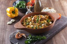 Acorda: Portugal thick stew of bread, garlic and herbs with salt cod  or shrimp and poached egg.