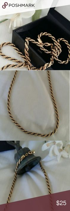 "Gold-toned and Black Twisted Rope Necklace Rope Necklace.   This is a beautiful piece with some weight to it without feeling heavy.  Length:  24""  Box not included. Jewelry Necklaces"