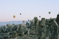 Cappadocia- sky filled with hot air balloons over the fairy tale chimneys