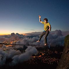 "@natgeophotos's photo: ""MAY 29, 2012  Slackline, Rio de Janeiro Photograph by Tim Kemple  This Month in Photo of the Day: Adventure and Exploration Photos  The sunset slackline image is of my good friend Renan Ozturk slacklining over the Gavea Stone in Rio de Janeiro, Brazil.  Find out the story behind this shot and see more pictures of extreme adventure sports."""