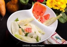 Royalty Free food stock photography from Alamy: Bowl with salad of fennel, pears and white cheese together with smoked salmon.
