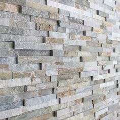 3D Tile on wall. Gorgeous!! https://www.pebbletileshop.com/products/3d-Polished-Grey-Brick-Stone-Tile.html#.VcOa2flViko