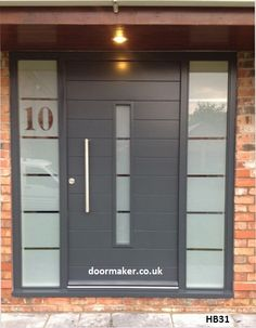 grey entrance door - .I like the house number. Thats a good idea.