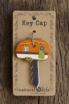 Orange camper key cap. Bright rubber key cap with orange camper design with ball chain key ring. Fits standard keys approximately 1 1/2″ round.@Sarah Chintomby Crumly