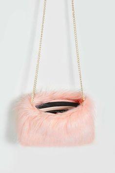 A mini crossbody bag featuring a faux fur design, chain link shoulder strap, top zipper closure, and an interior zippered pocket. Fur Purse, Fur Bag, Trendy Handbags, Purses And Handbags, Cute Mini Backpacks, Kawaii Bags, Diy Handbag, Cute Purses, Girls Bags