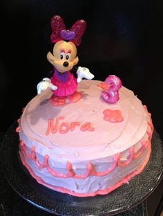Made from scratch strawberry cake with cream cheese frosting and Minnie decorations.