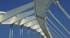 The Felipe II / Bach de Roda Bridge, Barcelona, 1985-87, designed by Santiago Calatrava, uses four tied arches to carry the road deck over a multi-track railway line.