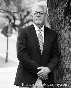 Sharp dressed man in black and white. Portrait of business man by tree. Simple portrait but nice. #portrait #business #photography