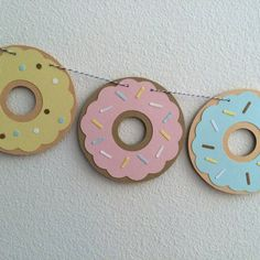 This popular item is now available in pastels!  The only thing better than real donuts is a paper garland replica of these sugary, sweet treats.