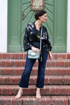 Modern styling of a kimono with jeans for spring