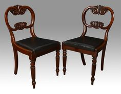 set of four William IV rmahoganyballoon back dining chairs, each with cartouche and scroll carved crest and back rail, above black leather drop in seat raised up on carved tapered legs