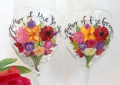 Personalized Bridesmaid Glasses – Hand Painted to replicate YOUR EXACT details of your wedding gown, bridesmaid dresses, tuxes flowers and other details of your wedding  {www.samdesigns.net} , $28 ea.