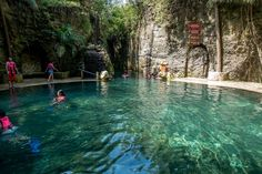 Entering one of the blissful underground rivers at Xcaret park in Playa del Carmen, Mexico. A day at the park gives visitors access to water-based activities, culture, and entertainment.