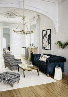 Incredible Living room with classic architectural details a blue velvet upholstered couch, and a low-hanging gold chandelier   The post  Living room with classic architectural details a blue velvet upholstered couch, …  appeared first on  Cazoz Diy Home Decor .