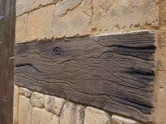 Tematización de piedra natural y madera.