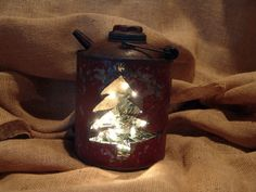 This listing is for an antique gas can that has been repurposed into a creative Christmas decoration! It is lit with standard string lights and