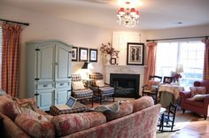 love the toile sofa, red checked curtains, blue armoire