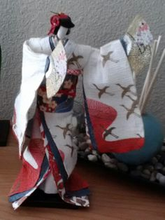 Japanese washi ningyo (paper doll). Is made entirely from Japanese paper.