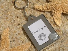 Seashell Photo Frame Key Chain Favors (Cassiani Collection 4321)   Buy at Wedding Favors Unlimited (http://www.weddingfavorsunlimited.com/seashell_photo_frame_key_chain_favors.html).