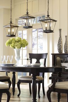 Grouped lanterns above a dining room table add a contemporary flair to your traditional home.