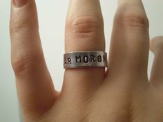 "Valar Morghulis Ring Arya Stark & Jaqen H'ghar GAME OF THRONES Faceless Man of Braavos Inspired Geekery Aluminum Adjustable     ""Valar morghulis"" is High Valyrian for ""all men must die"".     This adjustable silver aluminum ring is hand stamped with the words, ""VALAR MORGHULIS"". Pliable enough to GENTLY bend and shape it to fit your own finger by SHOWPONYSTORE, $5.80"