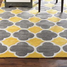 Cloverleaf Quatrefoil with Gray - 3 colors This classic quatrefoil pattern outlined in white loop pile is fresh and modern in popular gray color combinations. Crisp color contrast and simple geometry are woven in a plush cut and loop pile construction for dimension and durability. Select from Yellow with charcoal gray, Sea Blue with silver, or charcoal Gray with silver. 100% Poly/Acrylic pile can be spot cleaned with mild soap and water